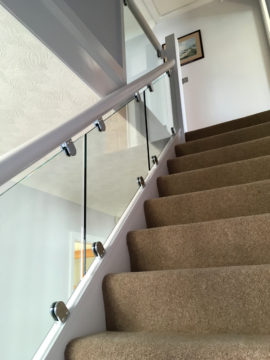 Staircase glass panel